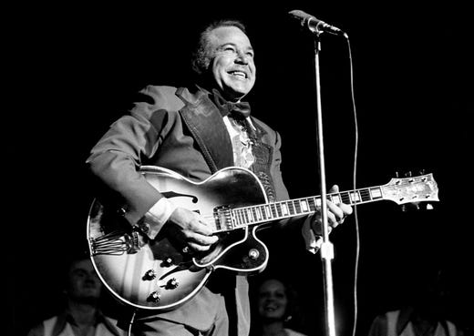 "Roy Clark performs during the ""Lewis and Clark Entertainment Expedition"" benefit show at the Municipal Auditorium on June 24, 1975. The event was sponsored by McDonald's and the Nashville-Middle Tennessee Home Builders Association and produced by WLAC-TV."
