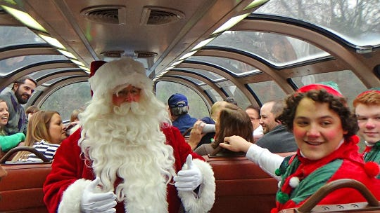 Passengers enjoy a visit with Santa on TCRY's North Pole Express.