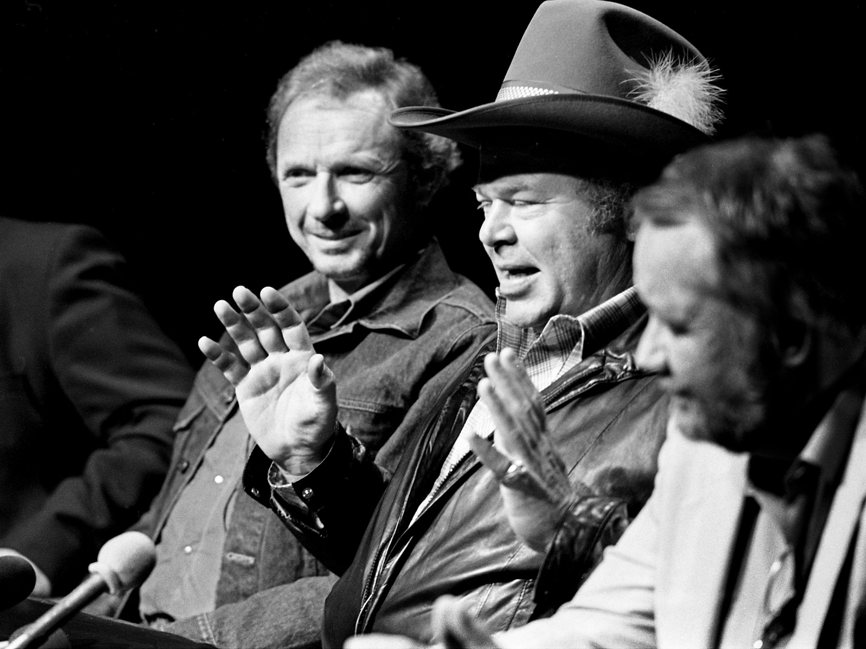 "Former CMA Entertainers of the Year Mel Tillis, left, and Roy Clark talk about ""Uphill All the Way,"" a feature comedy movie they are co-starring in, during a news conference at Jim Owens Entertainment on Oct. 5, 1984. They begin filming in Texas later this month."