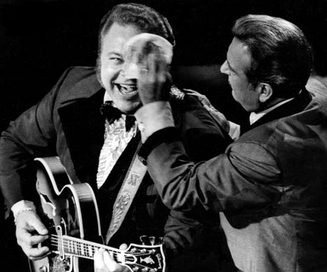Master of ceremonies Tennessee Ernie Ford, right, mops the fevered brow of Roy Clark during the nationwide telecast of the CMA Awards show Oct. 14, 1970. Clark won the Comedian of the Year award.