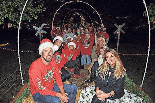 """Submitted Chad Barnard, left, and celebrity judge Sabrina Soto during filming for """"The Great Christmas Light Fight."""" Barnard's light display was featured on the TV show in 2014."""