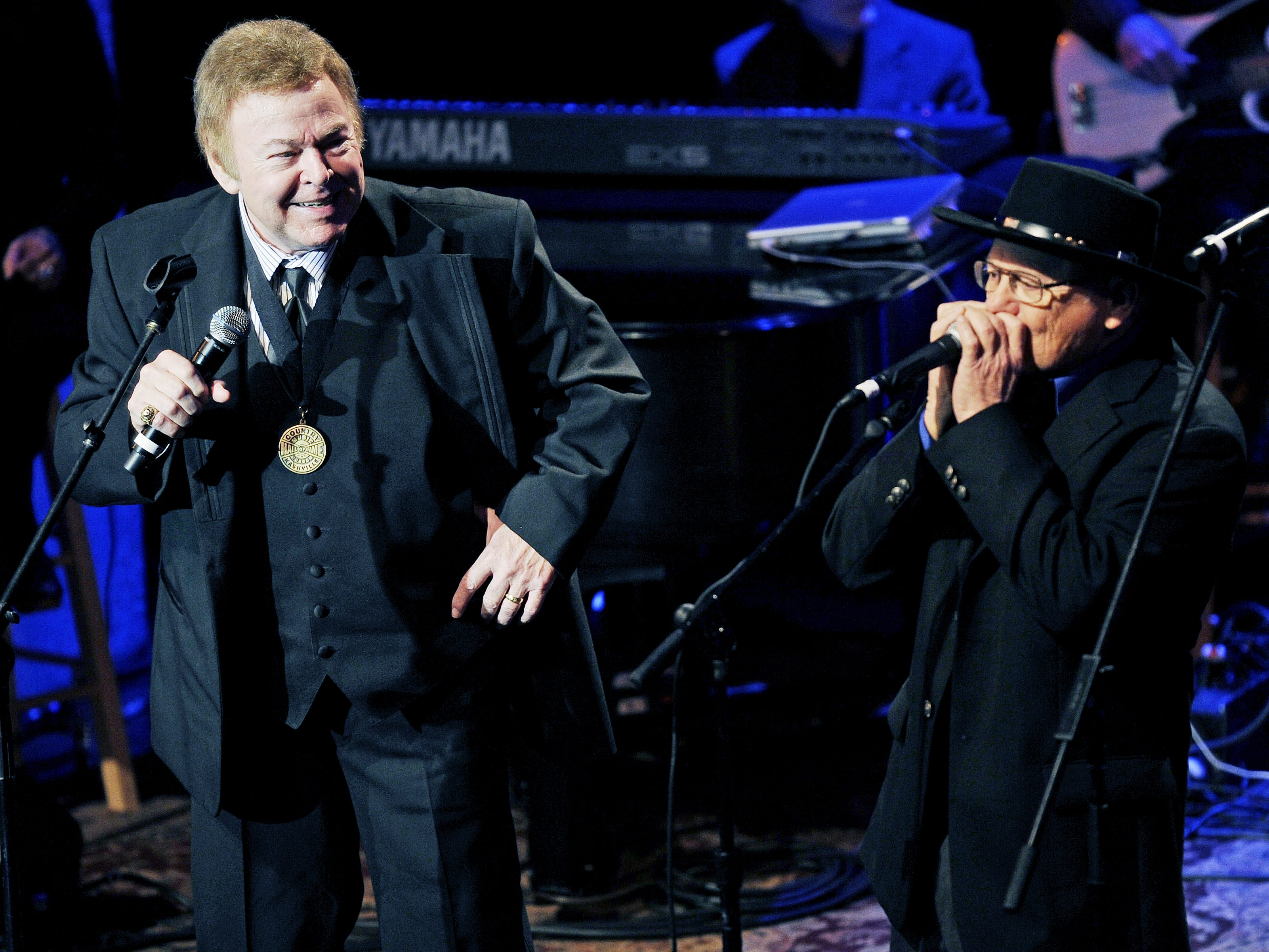 Roy Clark, left, and Charlie McCoy perform a tribute to Jimmy Dean during the Country Music Hall of Fame Medallion Ceremony at the Hall of Fame on Oct. 24, 2010.