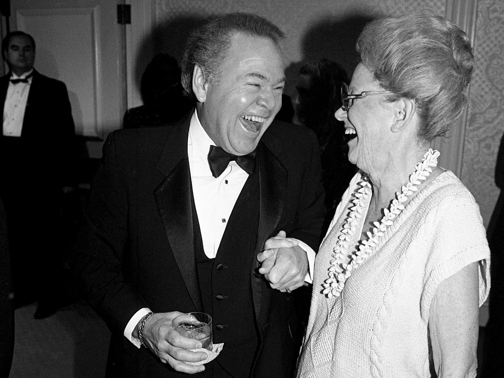 "Minnie Pearl tells Roy Clark he's the finest entertainer she's ever seen during a reception and dinner in Clark's honor, ""A Salute to Roy Clark,"" at the Sheraton Music City Hotel on Sept. 9, 1988. ""You distract me with the wicked grin every time we play a show together,"" she said."
