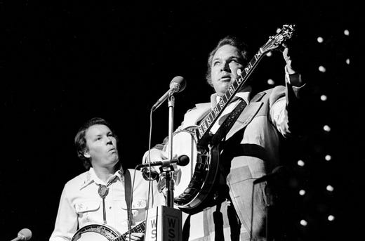 Roy Clark, right, and Buck Trent perform at the Music City Pro-Celebrity Golf Tournament sponsors party at Opryland on Oct. 10, 1974.