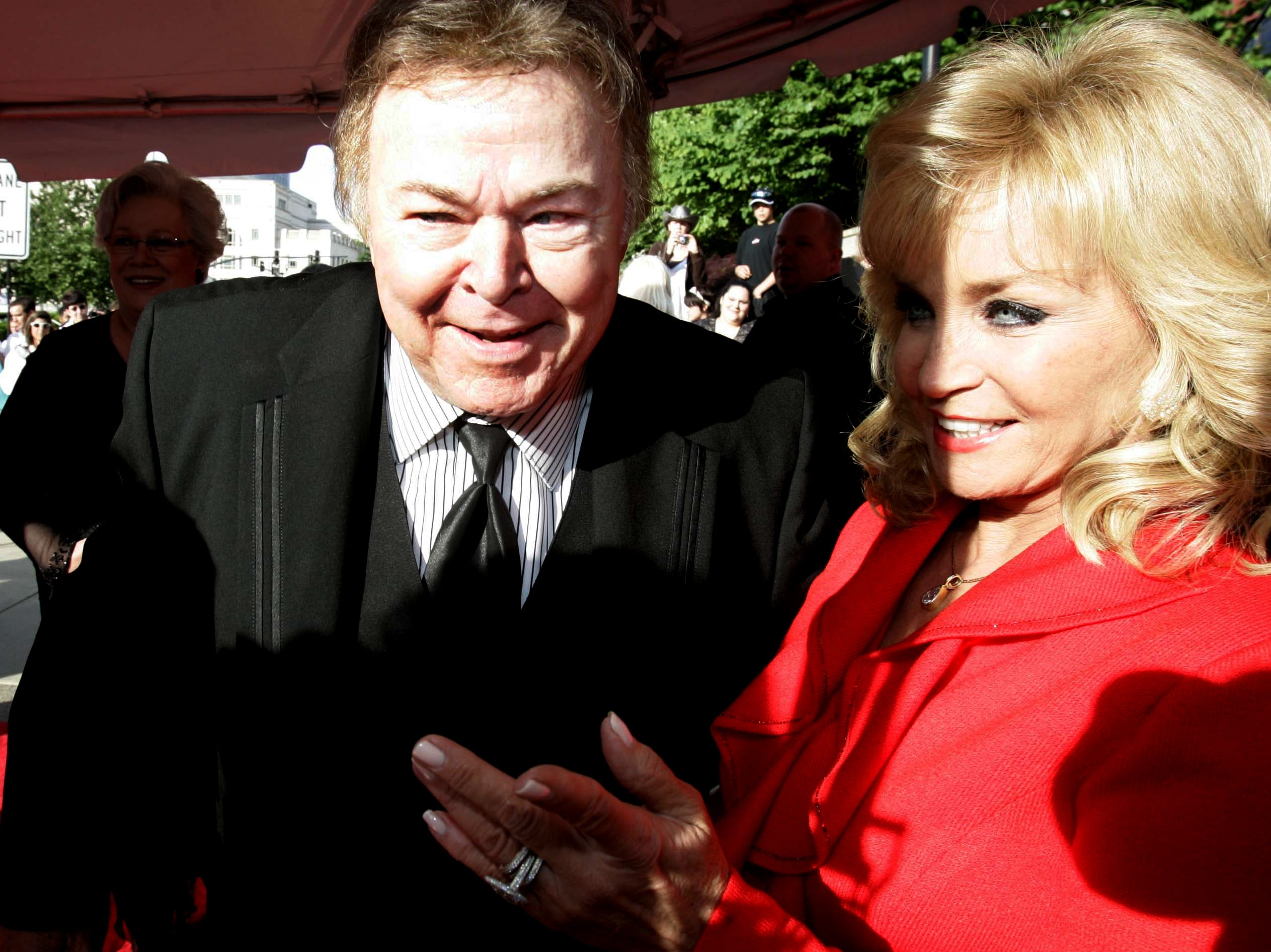 Roy Clark and Barbara Mandrell share a moment on the red carpet during the Country Music Hall of Fame's Medallion Ceremony on May 17, 2009.