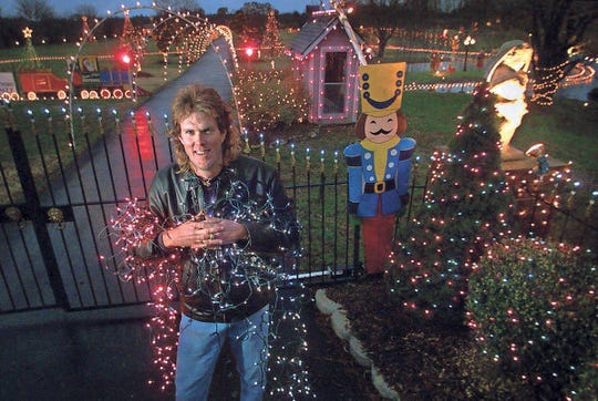Chad Barnard stands in front of a portion of his 800,000 Christmas lights in 2003.
