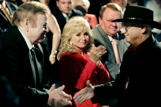 Roy Clark, left, and Barbara Mandrell applaud Charlie McCoy during the Country Music Hall of Fame's Medallion Ceremony on May 17, 2009. All three were inducted at the ceremony.
