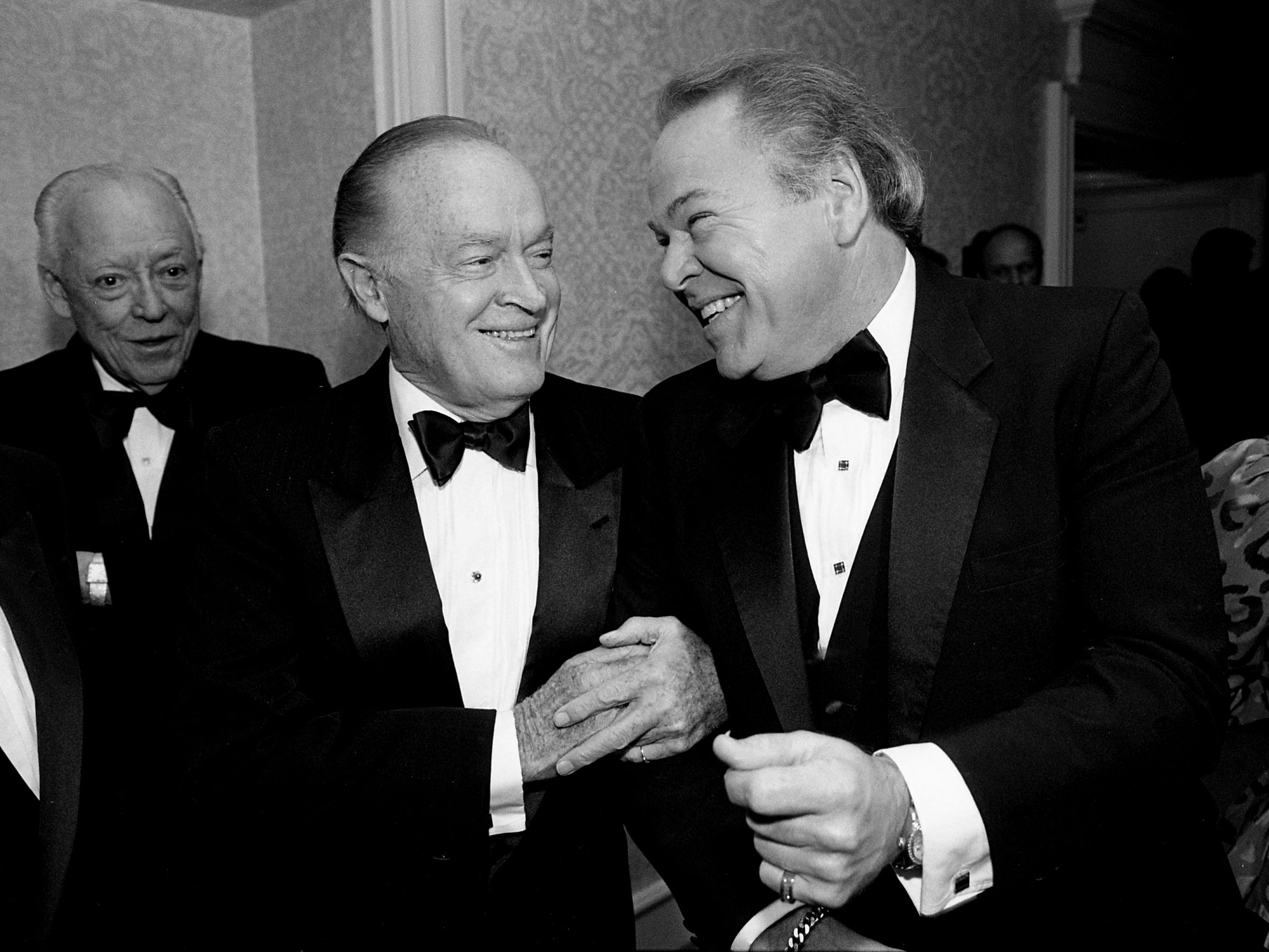"Bob Hope, left, shares a joke with his friend Roy Clark during a reception and dinner in Clark's honor, ""A Salute to Roy Clark,"" in the Plantation Ballroom of the Sheraton Music City Hotel on Sept. 9, 1988."