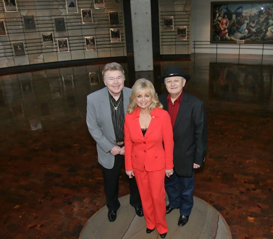 Charlie McCoy (far right) poses with country stars Roy Clark and Barbara Mandrell in 2009, the same year all three artists were indicted into the Country Music Hall of Fame in Nashville.