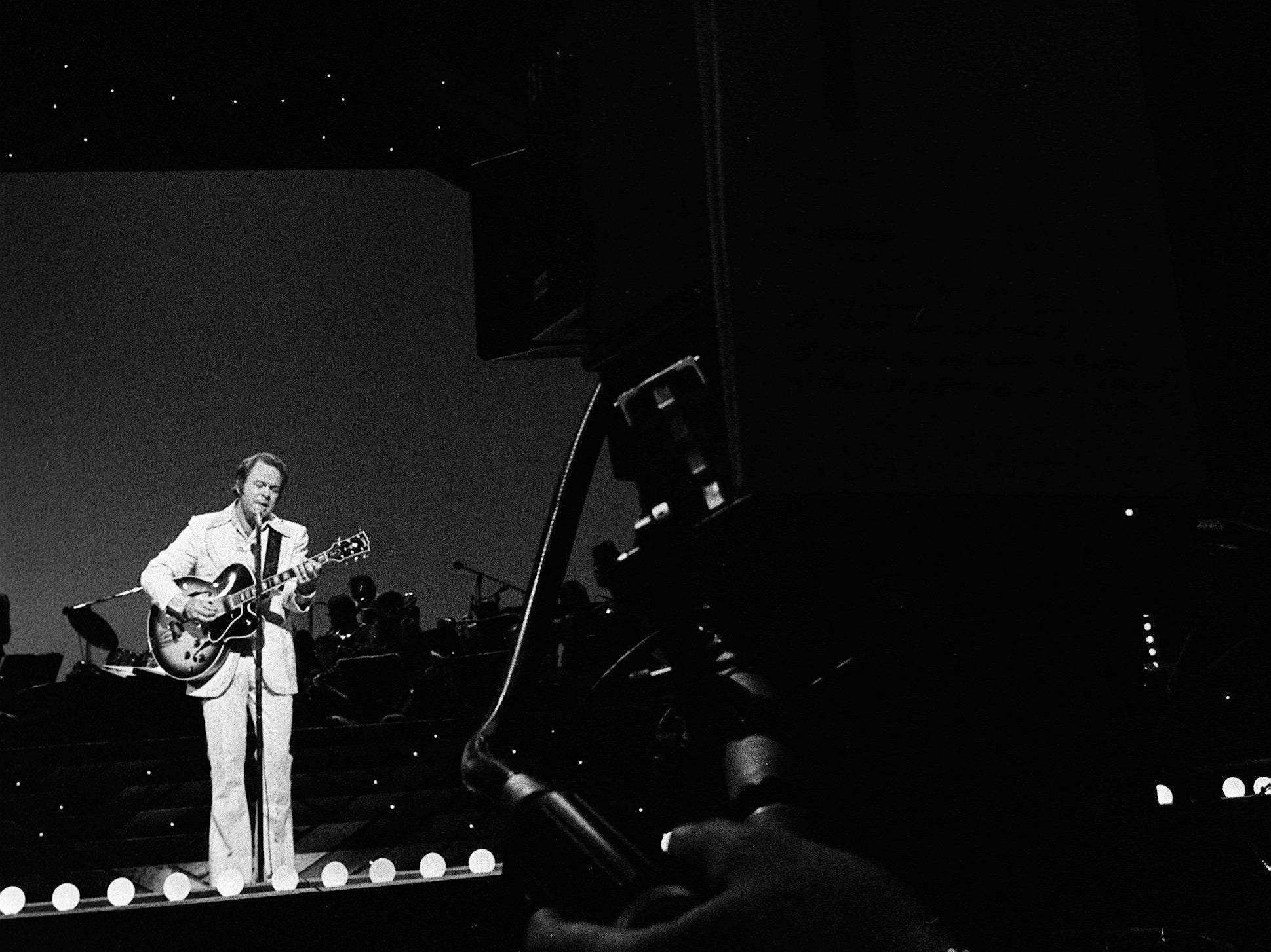 "Roy Clark performs during the taping of ""The Grand Ole Opry at 50, A Nashville Celebration"" for a nationally televised special at the Opry House on Oct. 23, 1975."