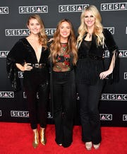 From left: Hannah Mulholland, Naomi Cooke and Jennifer Wayne of Runaway June on the red carpet at the SESAC Nashville Music Awards at the Country Music Hall of Fame and Museum on Nov. 11 in Nashville, Tenn.