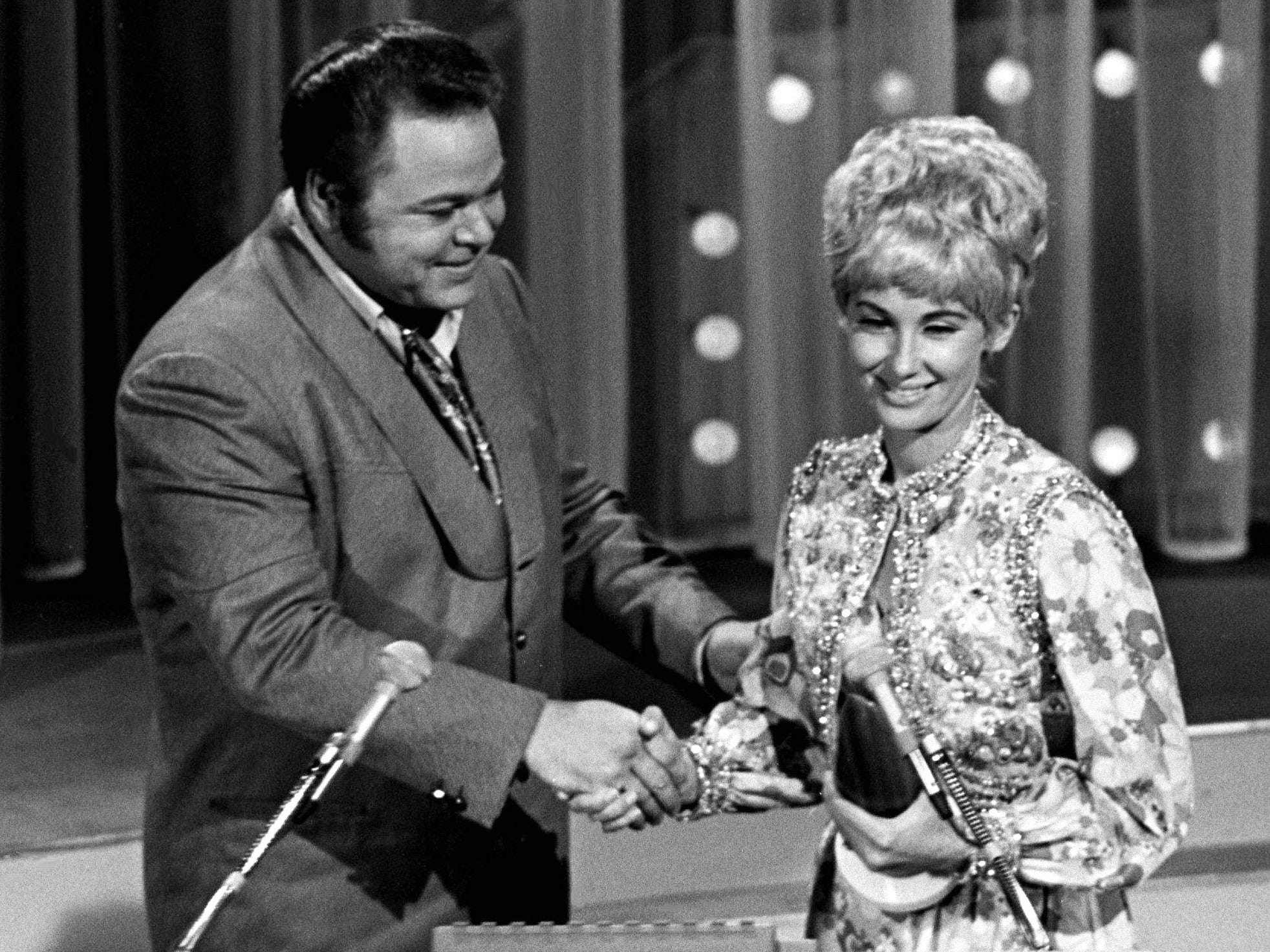 Tammy Wynette receives the Female Vocalist of the Year award from presenter Roy Clark during the CMA Awards show at the Ryman Auditorium on Oct. 15, 1969.