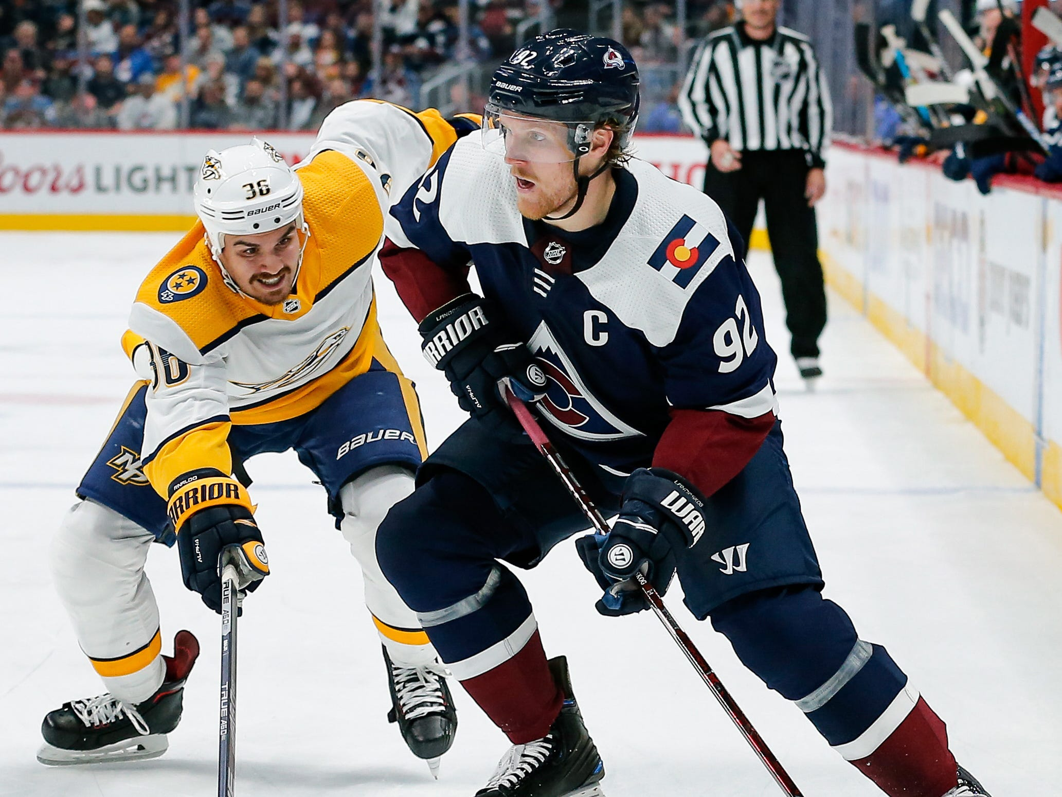 Nashville Predators left wing Zac Rinaldo (36) defends against Colorado Avalanche left wing Gabriel Landeskog (92) in the second period at the Pepsi Center.
