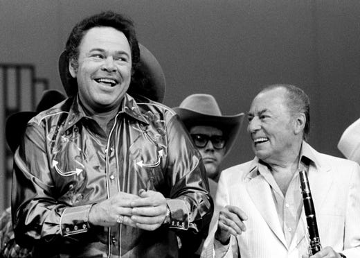 "Roy Clark, left, and Woody Herman perform during a taping of the ""Nashville Palace"" show at Opryland on Sept. 16, 1981."