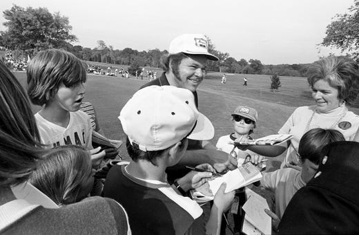 Country music entertainer Roy Clark, center, is all smiles as he signs autographs for fans during a break at the 10th annual Music City Pro-Celebrity Golf Tournament on Oct. 12, 1974.