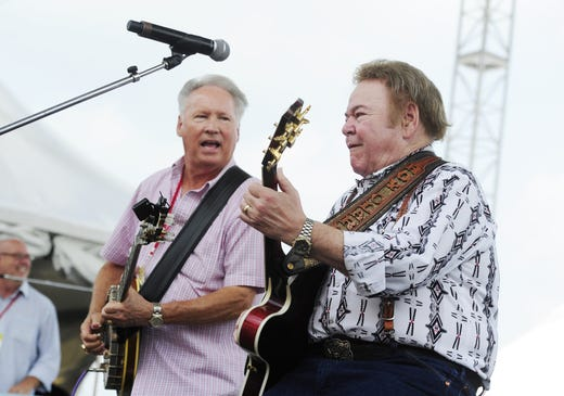 Roy Clark, right, performs with Buck Trent during the CMA Music Festival in downtown Nashville on June 12, 2011.