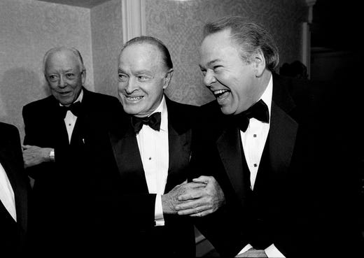 "Bob Hope, left, jokes with his friend Roy Clark during a reception and dinner in Clark's honor, ""A Salute to Roy Clark,"" in the Plantation Ballroom of the Sheraton Music City Hotel on Sept. 9, 1988."
