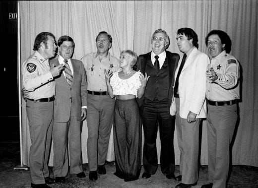Roy Clark, left, Mack Smith, Gordie Tapp, Diane Sherill and Buck McPherson share a moment at the fundraising show and dinner for the Citizens for the Metropolitan Council political committee at the Tennessee State Fairgrounds on June 23, 1977.