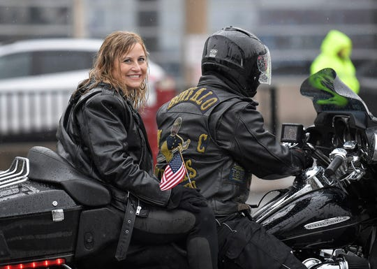 Former Mayor Megan Barry rides on a motorcycle in the rain during the  Nashville Veterans Day Parade on Nov. 12, 2018.
