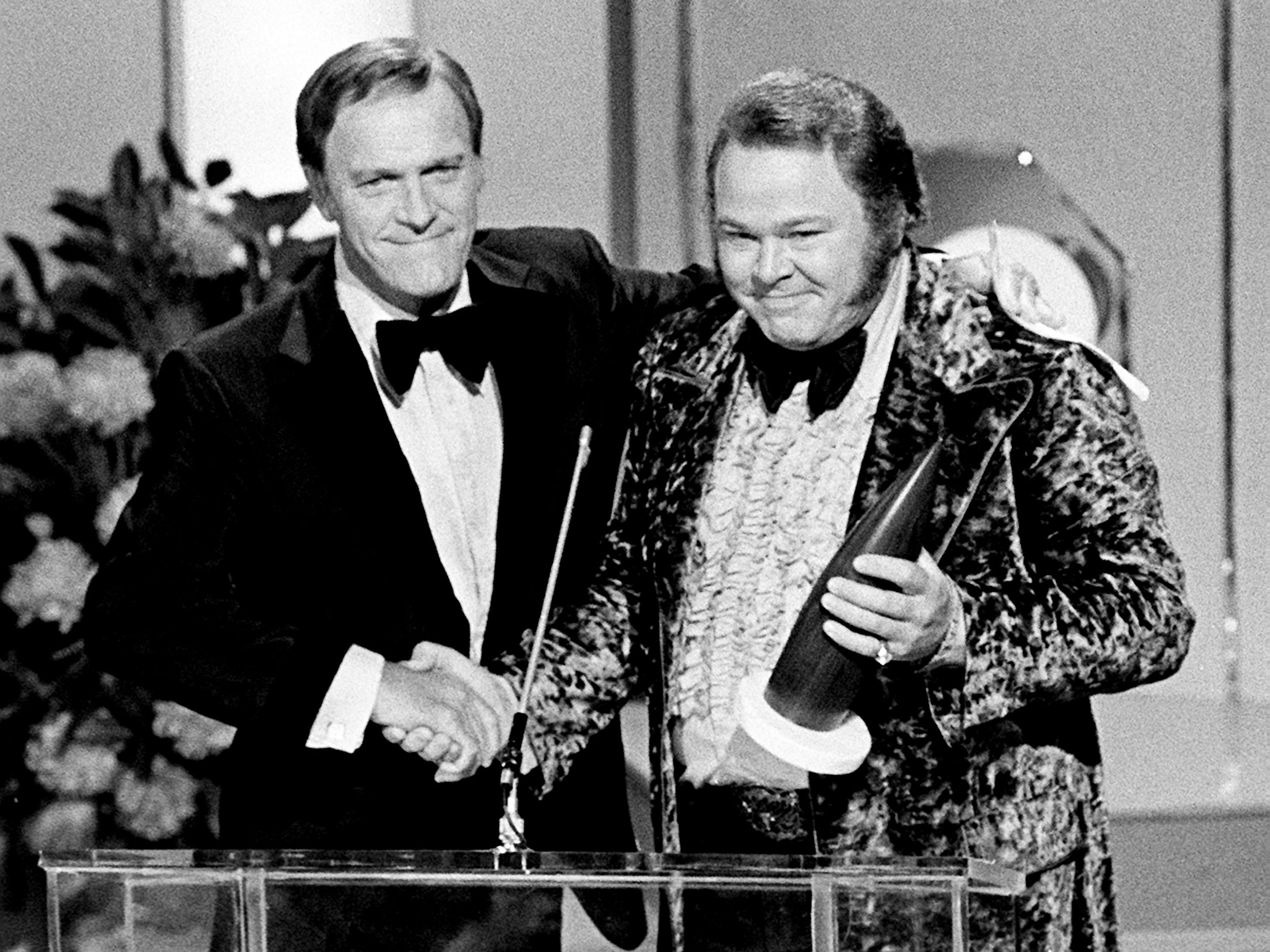 Roy Clark, right, receives congratulations from presenter Eddy Arnold after winning the coveted Entertainer of the Year award at the seventh annual CMA Awards show at the Grand Ole Opry House on Oct. 15, 1973.