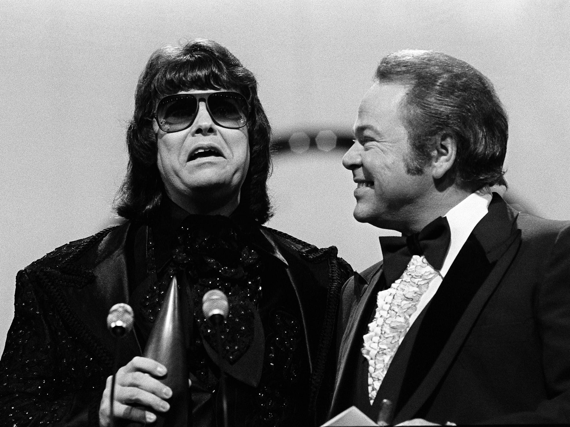 "Ronnie Milsap, left, with presenter Roy Clark looking on, accepts his Album of the Year award during the 12th annual CMA Awards show Oct. 9, 1978. Milsap won the honor with ""It Was Almost Like a Song."""