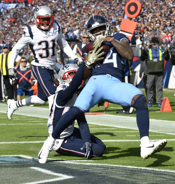 Nov. 11: Titans 34, Patriots 10 -- Titans wide receiver Corey Davis (84) hauls in a Titans quarterback Marcus Mariota (8) touchdown pass in the first quarter at  Nissan Stadium Sunday, Nov. 11, 2018, in Nashville, Tenn.