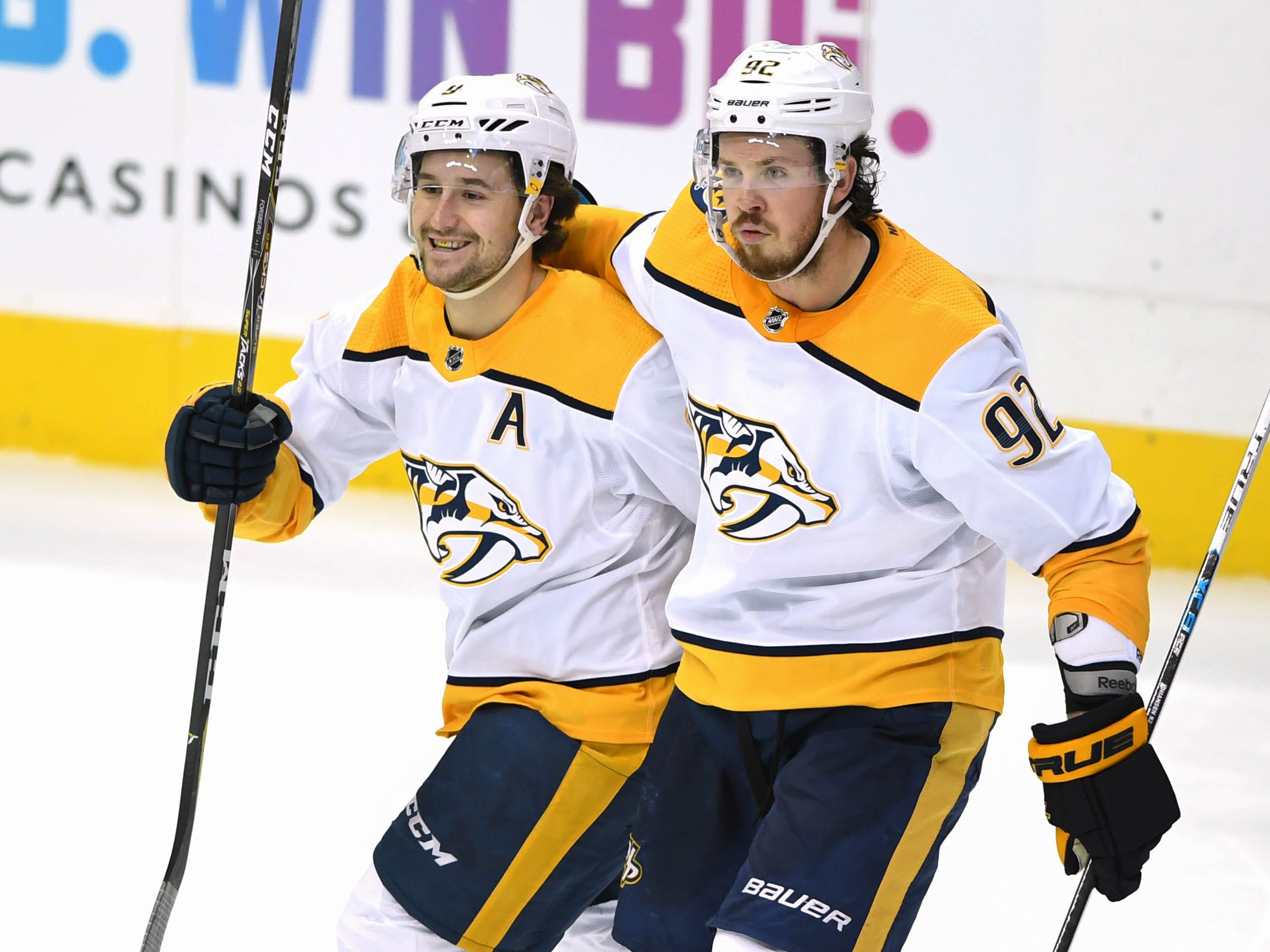 Nashville Predators left wing Filip Forsberg (9) and center Ryan Johansen (92) react at the end of the game against the Dallas Stars during overtime at American Airlines Center.