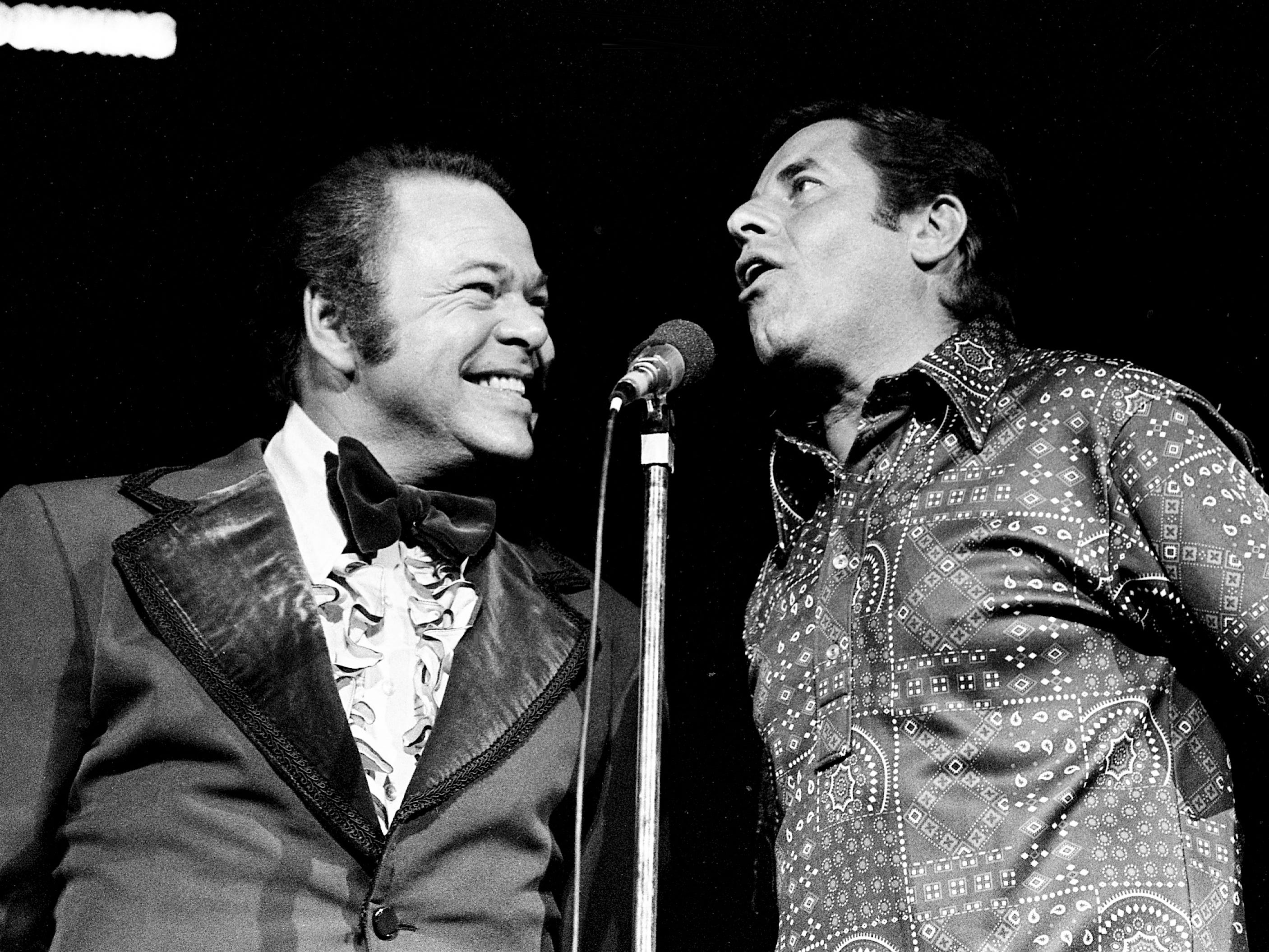 "Roy Clark, left, and Jerry Lewis perform for a few laughs during the ""Lewis and Clark Entertainment Expedition"" for the benefit of muscular dystrophy patients at the near-capacity Municipal Auditorium on June 24, 1975."