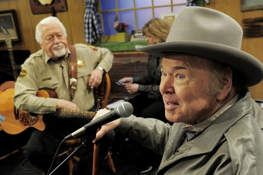 "Roy Clark, right, performs on the ""Larry's Country Diner"" TV show Feb. 4, 2013."