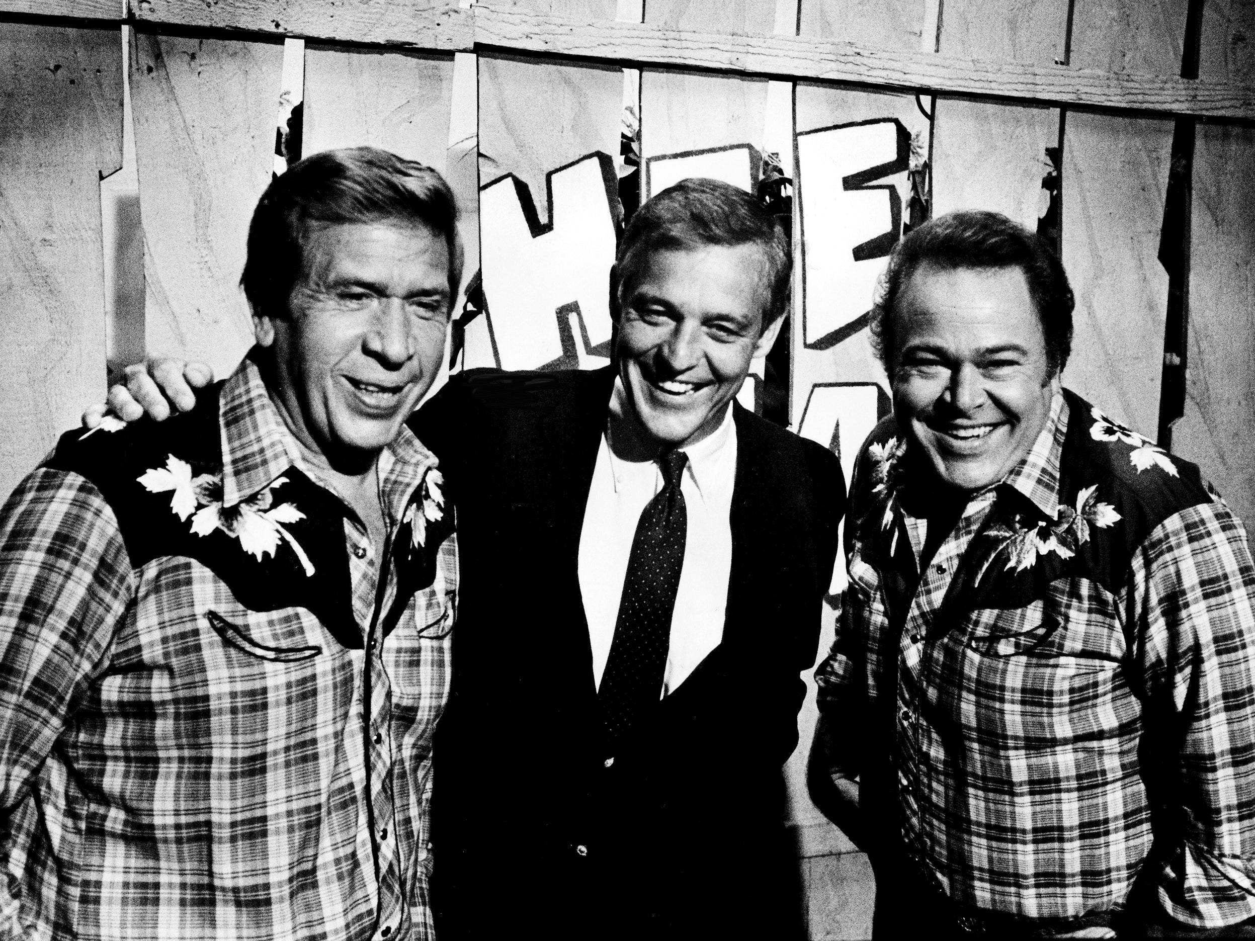 "William Banowsky, center, president of Dallas-based Gaylord Broadcasting Co., jokes with co-hosts Buck Owens, left, and Roy Clark during a visit June 18, 1985, to the Nashville set of ""Hee Haw,"" which is produced by Gaylord Program Services, a subsidiary operation."
