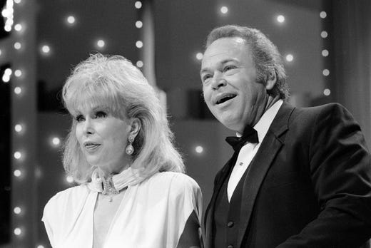 Hosts Barbara Eden and Roy Clark introduce the next act during the nationally televised sixth annual National Songwriter Awards show at the Tennessee Performing Arts Center on Jan. 13, 1986.