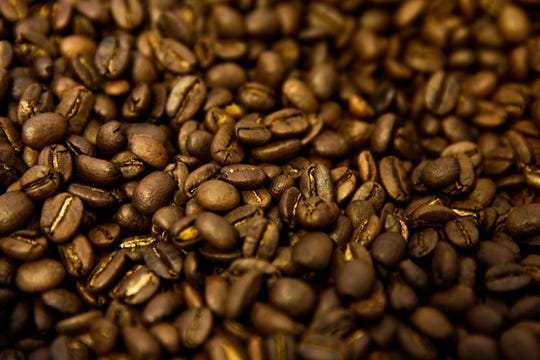 Roasted coffee beans ready to be packaged at Black Tulip Coffee in Naples on Thursday, December 17, 2015.