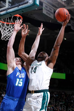 Michigan State's Nick Ward, right, shoots against Florida Gulf Coast's Ricky Doyle during the first half Sunday in East Lansing, Mich.