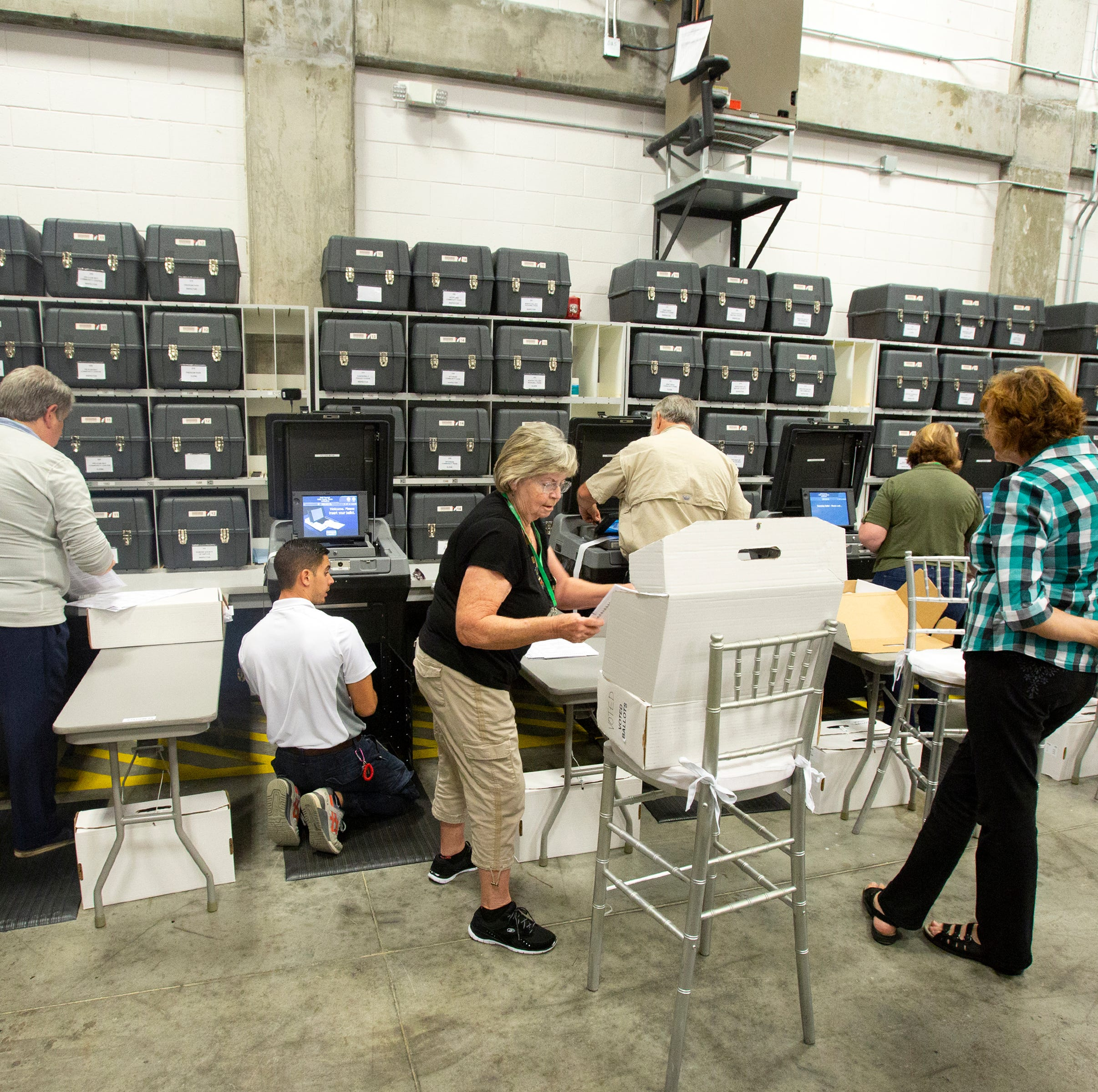 Elections workers process ballots during an election recount at the elections office on Enterprise Avenue Monday, Nov. 12, 2018 in Naples, Florida.