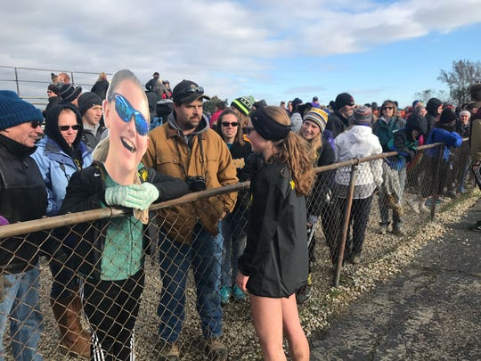 Watkins Memorial senior Andrea Kuhn talks to family and friends following Saturday's Division I state meet at National Trail Raceway.