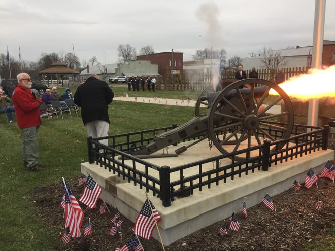 Councilman Tim Hickin fires the cannon at the conclusion of the City of Pataskala's Veterans Day ceremony, Nov. 12.