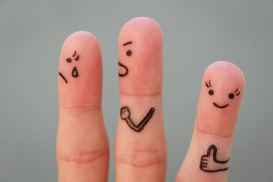 Fingers art of couple during quarrel. Another woman is happy.