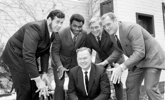 Wellington Mara, owner of the New York Giants of the NFL, introduces four of the team's new players outside Leone's restaurant in New York City, Feb. 5, 1970. Behind Mara, from left: defensive tackle Jim Kanicki and running back Ron Johnson, both obtained from the Cleveland Browns; linebacker Jim Files, no. 1 draft choice from the University of Oklahoma, and defensive tackle Jerry Shay, obtained from the Atlanta Falcons. (AP Photo/Marty Lederhandler)