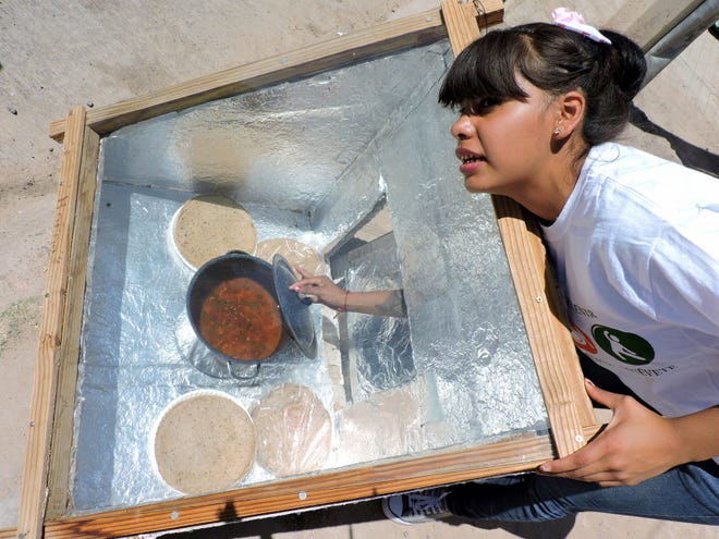 Palomas students cooked beans and warmed tortillas in a solar oven during a bi-annual health fair organized by Border Partners' Health Promoters.