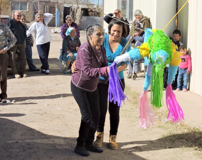 Health Promoters working with Border Partners offer a weekly lunch and activity program for seniors.  The program encourages god nutrition and social interaction like a pinata bust.