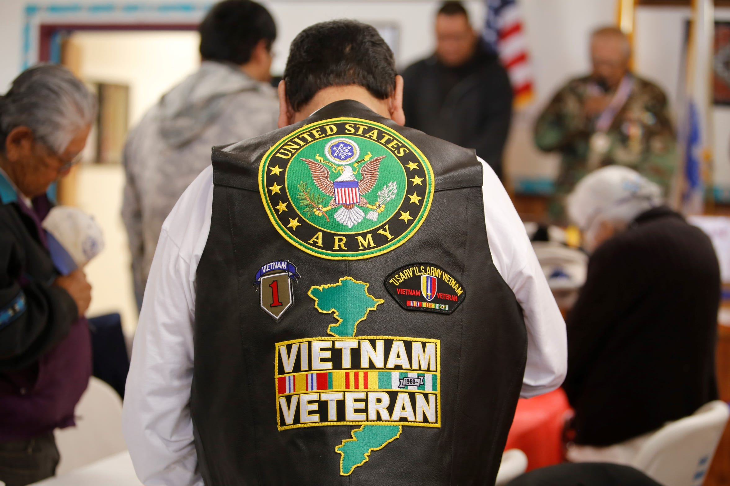 Emerson Watchman, an Army veteran who served in the Vietnam War, stands for a prayer during the Veterans Day event on Monday at the Tooh Haltsooí Chapter house in Sheep Springs.
