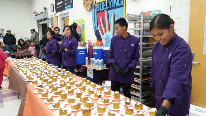 High school culinary arts students serve dessert and tea at the annual Mescalero Apache schools  Thanksgiving dinner for the children, parents or family members. The Middle School luncheon is Nov. 16.