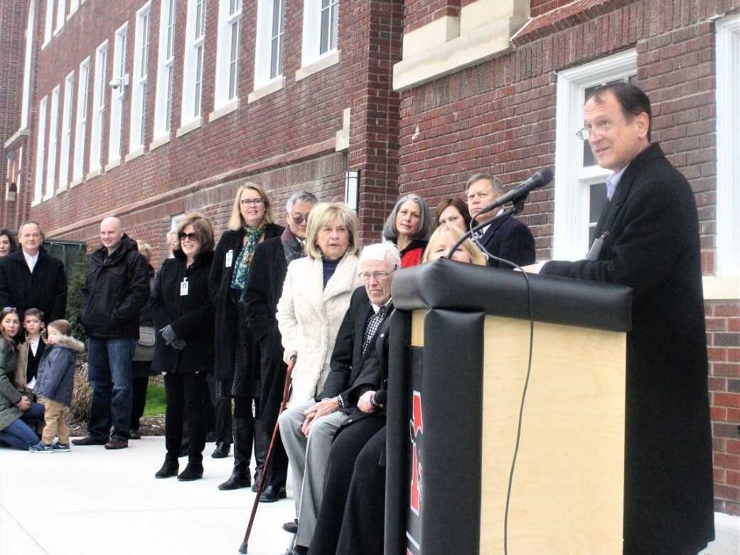 Northville School Board President James Mazurek addresses the large crowd present at Sunday's Old Village School open house.