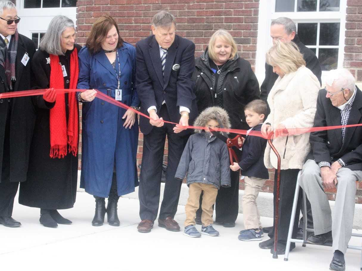 Four-year-old William Fitzgerald cuts the  ribbon during Sunday's open-house festivities.