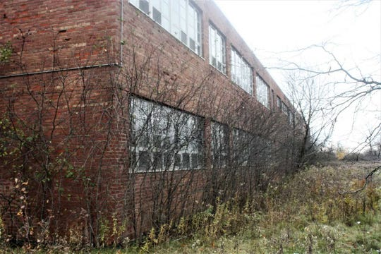 Delays in demolition mean this secondary building on the former state psychiatric hospital site in Northville Township will still be standing in 2019.