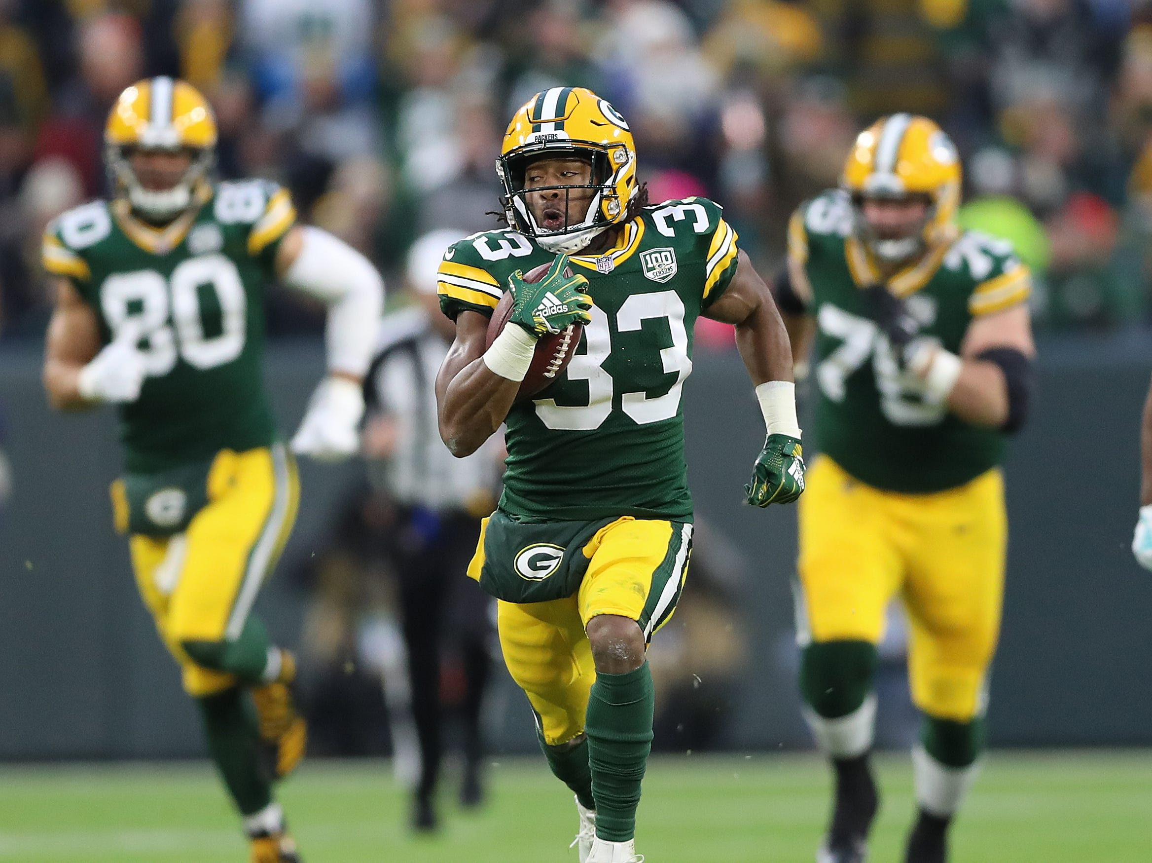 Green Bay Packers running back Aaron Jones (33) breaks into the clear on a long run against the Miami Dolphins at Lambeau Field Sunday, November 11, 2018 in Green Bay, Wis. Jim Matthews/USA TODAY NETWORK-Wis