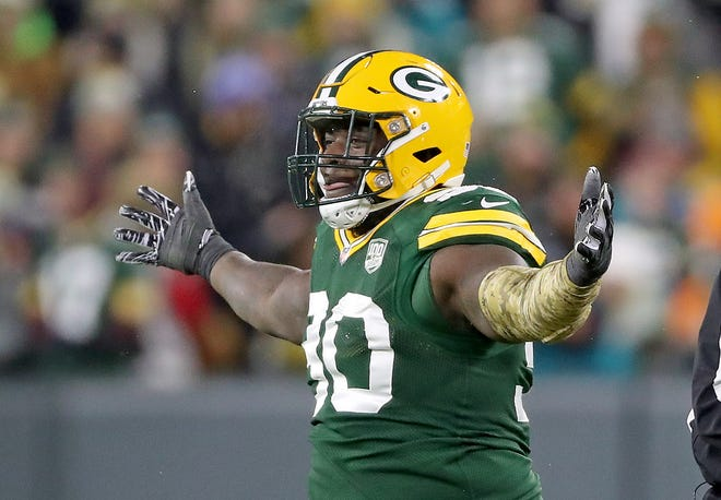 Packers defensive tackle Montravius Adams celebrates a sack against the Dolphins in 2018.