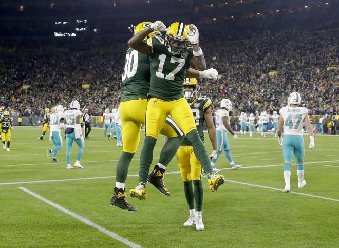 Green Bay Packers wide receiver Davante Adams (17) celebrates his touchdown with teammates during the 3rd quarter of the Green Bay Packers  game against the Miami Dolphins at Lambeau Field in Green Bay, Wis. on Sunday, November 11, 2018. Mike De Sisti / USA TODAY NETWORK-Wis