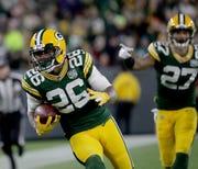 Green Bay Packers defensive back Bashaud Breeland returns an interception against Miami last November.