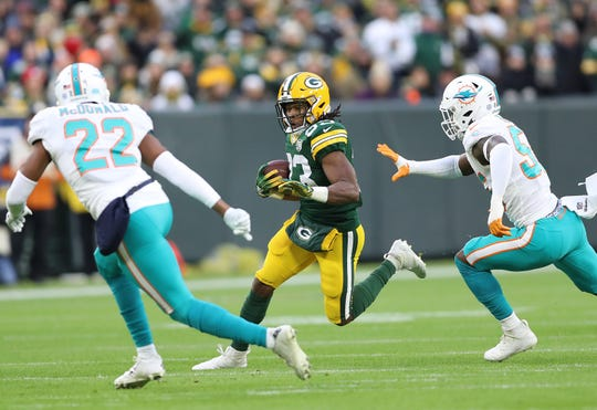 Green Bay Packers running back Aaron Jones (33) runs against the Miami Dolphins at Lambeau Field Sunday, November 11, 2018 in Green Bay, Wis. Jim Matthews/USA TODAY NETWORK-Wis